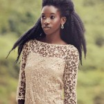 Black woman with long natural hair and nice top