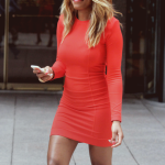 Black woman with blond hair wears a red dress