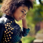 Beautiful ebony girl with natural hair wears a nice leather jacket