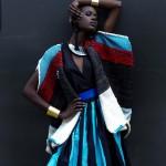 Black woman wears a wonderful black and blue dress