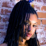 Long fine locs. Nice hairstyle !