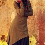 Ebony girl has long braids and wears a long dress