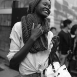Alek Wek wears wool bonnet and scarf