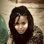 Ebony girl has perfect long braids. Class hairstyle.
