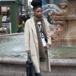 "Ebony girl has a ""big"" hairstyle and  wears a long coat. So fashion !"