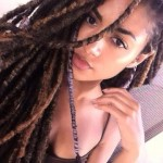 Ebony girl has long locs. Nice hairstyle !