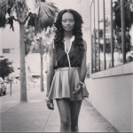 Ebony girls has long curly hair and wears a short dress. Nice hairstyle!