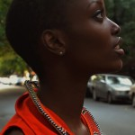 Beautiful black woman has a nice red necklace