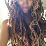 Beautiful black woman has an amazing hairstyle with dreadlocks