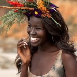 Beautiful black woman has a nice flowered hairstyle. Showdear Buomb Galou.