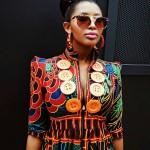 Fashion black girl wears an amazing colored dress