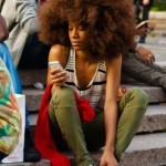 """Black girl has an amazing afro hairstyle """"gouffa"""" and wears green pants"""