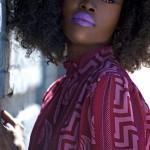 Beautiful black girl has purple lips and nice curly hair