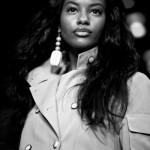 Beautiful black woman has long smooth hair and wears a nice raincot