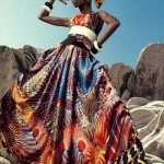 African fashion : black woman wears a wonderful colored dress