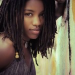 Pretty ebony girl has a nice hairstyle with dreadlocks