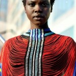 African fashion : black woman has short hair and wears a typical top