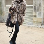 Fashion black woman wears a nice fur coat