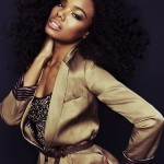 Beautiful black woman wears a nice jacket and has a voluminous curly hairstyle