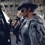 Naomi Campbell in grey. Grey fur jacket and hat. Wonderful glasses. Fashion.