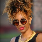 Black woman has curly hairstyle and nice glasses