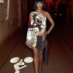 Naomi Campbell in the street wears a fashion nice dress