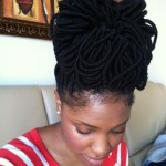 Black girl has amazing hairstyle with locs