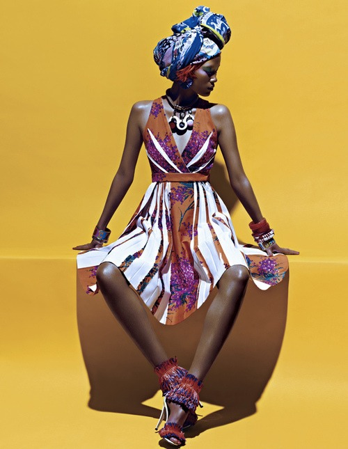 African fashion : Black woman wears a nice colored dress and a scarf