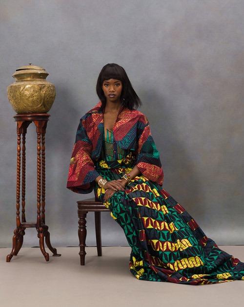 African fashion : black woman wears a nice long colored dress and has smooth hair