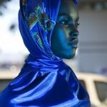 Beautiful black woman wears a wonderful blue scarf