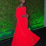 Lupita Nyong'o wears a wonderful red long dresse. Fashion.