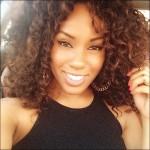 Smiling black girl has nice curly hair