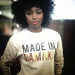 Inna Modja wears asweet-shirt by Fashizblack and has curly hairstyle
