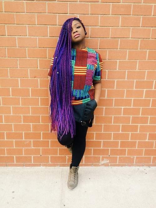 Black woman has an amazing hairstyle with very long purple braids