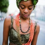 African fashion : black woman has a green headscarf and nice necklaces