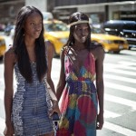2 black women has smooth hair and wears fashion dresses
