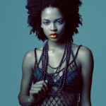 Beautiful black girl has natural hairstyle and wears necklaces
