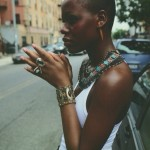 Black woman has amazing jewelry : necklace, bracelet, ring, earrings