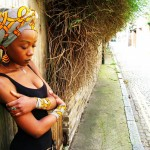 African fashion: black woman wears nice scarf and matching bracelets