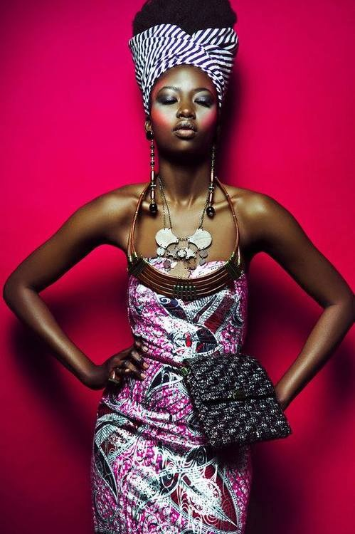 African fashion: black woman wears a nice dress and accessories