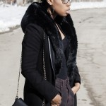 Fashion black girl wears a coat and has short hairstyle