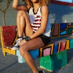Black girl wears a nice tank top and shorts