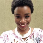 Smiling black woman has natural short hairstyle and a nice necklace