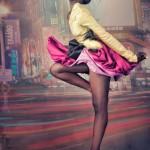 Fashion black woman wears a nice skirt. She looks like a flamingo.
