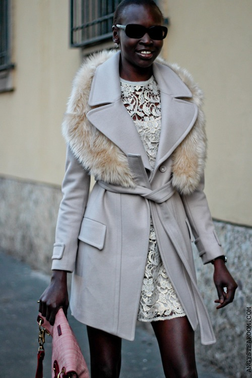 Alek Wek wears a very nice coat and dress