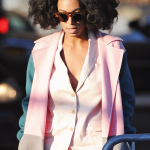Fashion Solange Knowles wears pink jacket and coat, has natural hair