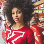 Cool natural hairstyle and red pullover