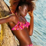 Nice colored swimsuit and amazing hairstyle