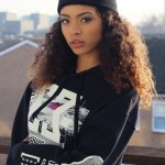 Streetwear style and long curly hair with cap