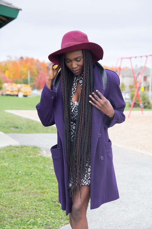 Blue coat, burgundy hat and long long braids